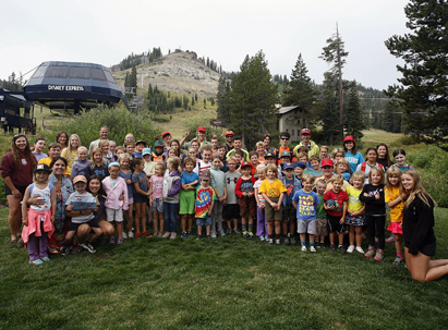 large groups of summer camp kids at the base of Mt. disney
