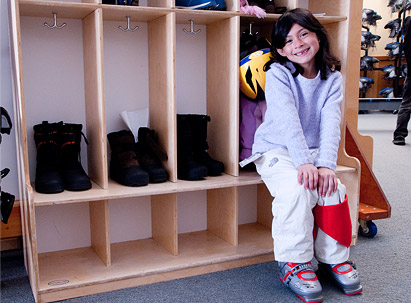 Season Lockers - A child getting ready at her family locker