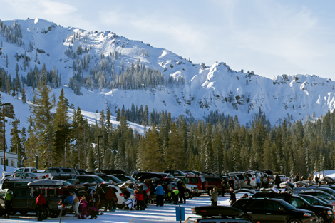A crowded parking lot in front with Mt. Lincoln in the background.