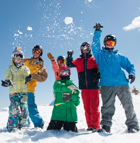 Group of skiers and snowboarders having fun in the snow at Sugar Bowl Ski Resort.
