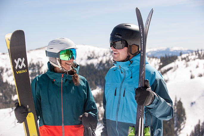Two skiers enjoying a day on the slopes at Sugar Bowl Resort after staying in the hotel.