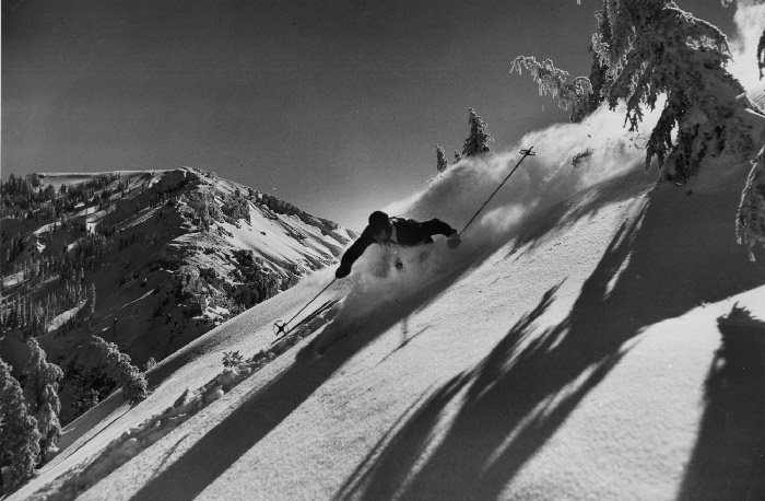 Historical Sugar Bowl Skier, Bill Klein making a left turn through deep powder atop Mt. Disney. Mt. Lincoln is shown in the background.