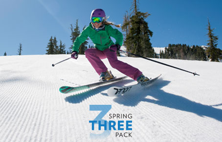 Women Skier turning on a groomer. Spring Three Pack text is overlaid.