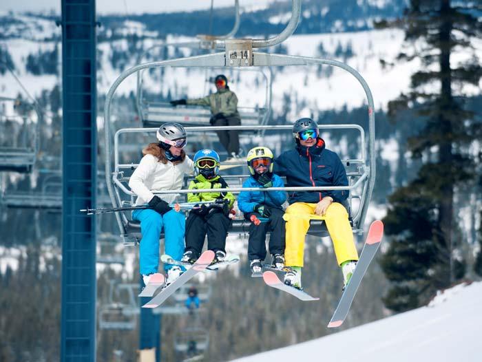 Skier enjoying the beautiful views of Castle Peak at Sugar Bowl Ski Resort.