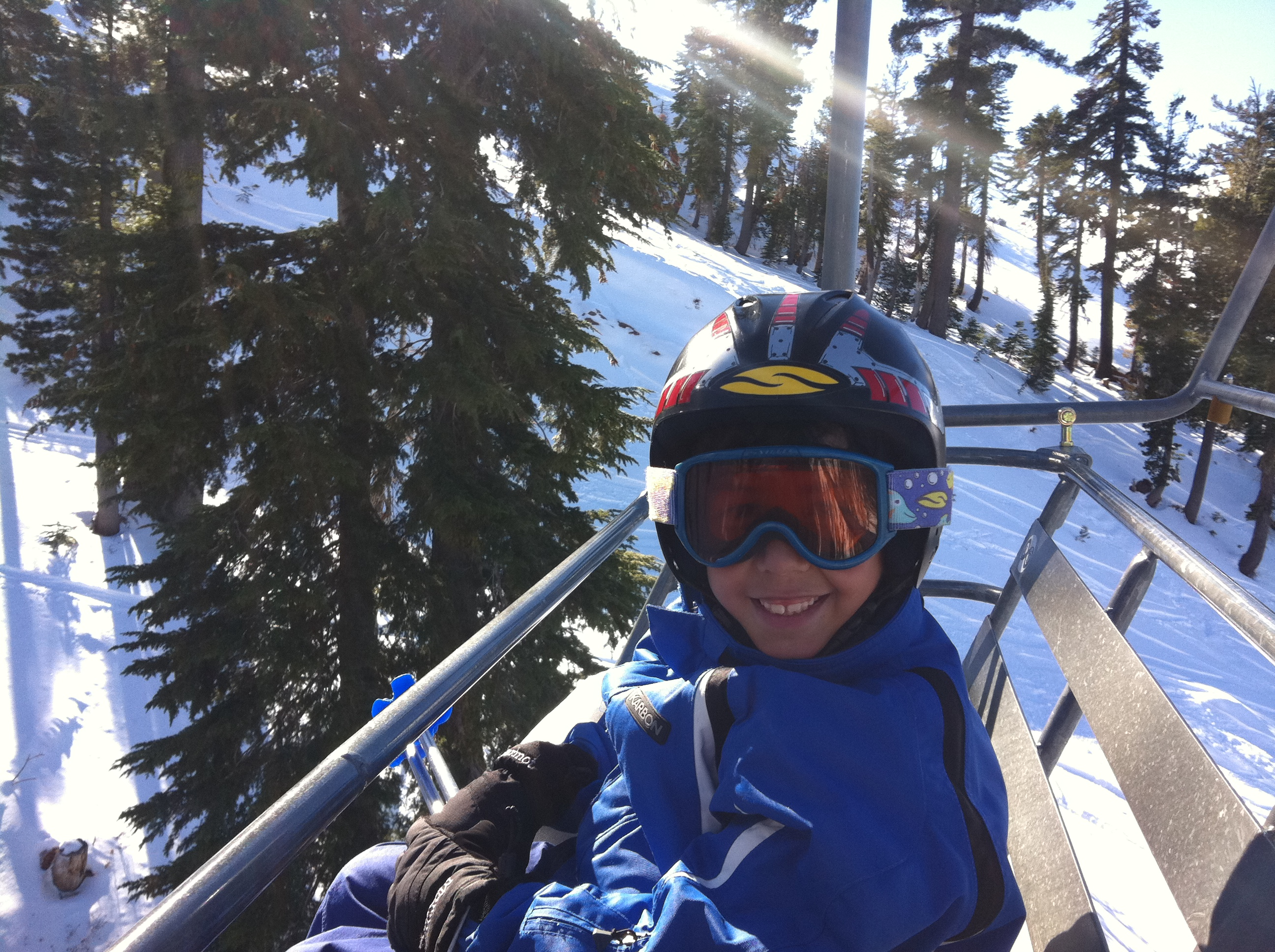 Chairlift Safety - smiling child on a chair lift