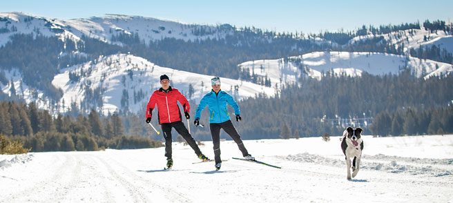 Skate Skiing - Two skate Skiers and dog enjoy  Royal Gorge