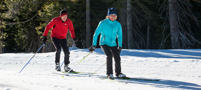 Skate Skiing - Two skate Skiers enjoy  Royal Gorge