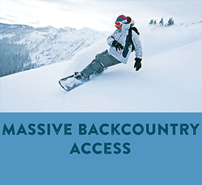 Massive Backcountry - Snowboarder Making a Powder turn