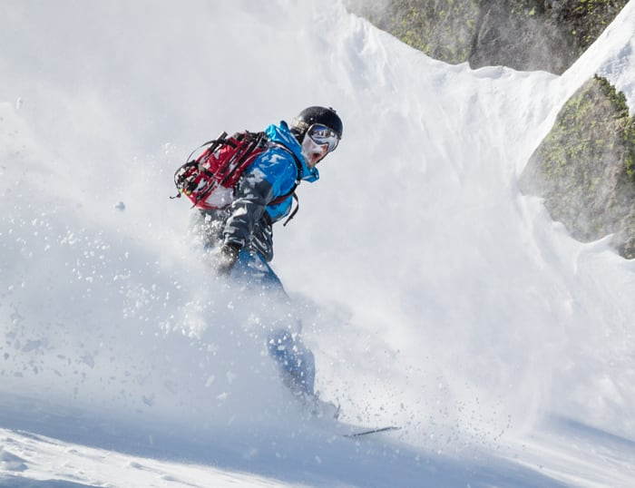 Backcountry snowboarder stoked on the fresh powder behind Sugar Bowl.