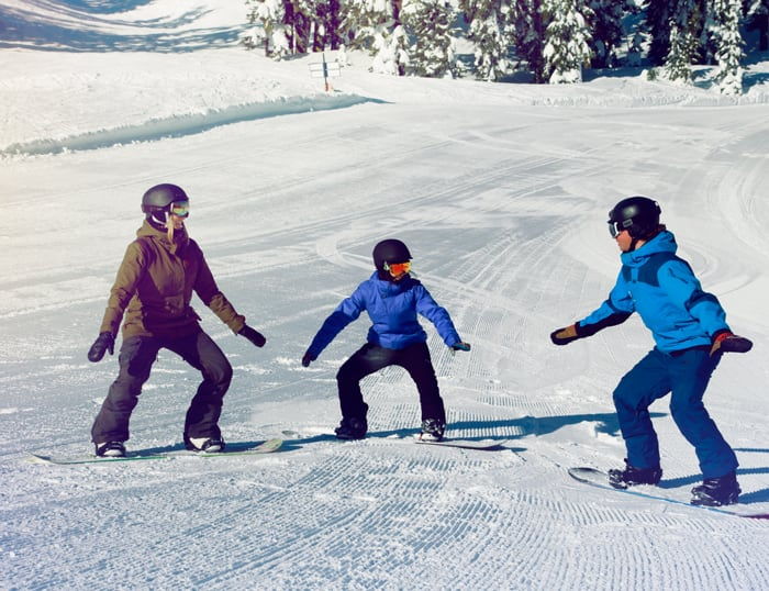 Group of new snowboarders learning from their experienced Sugar Bowl snowboard instructor.