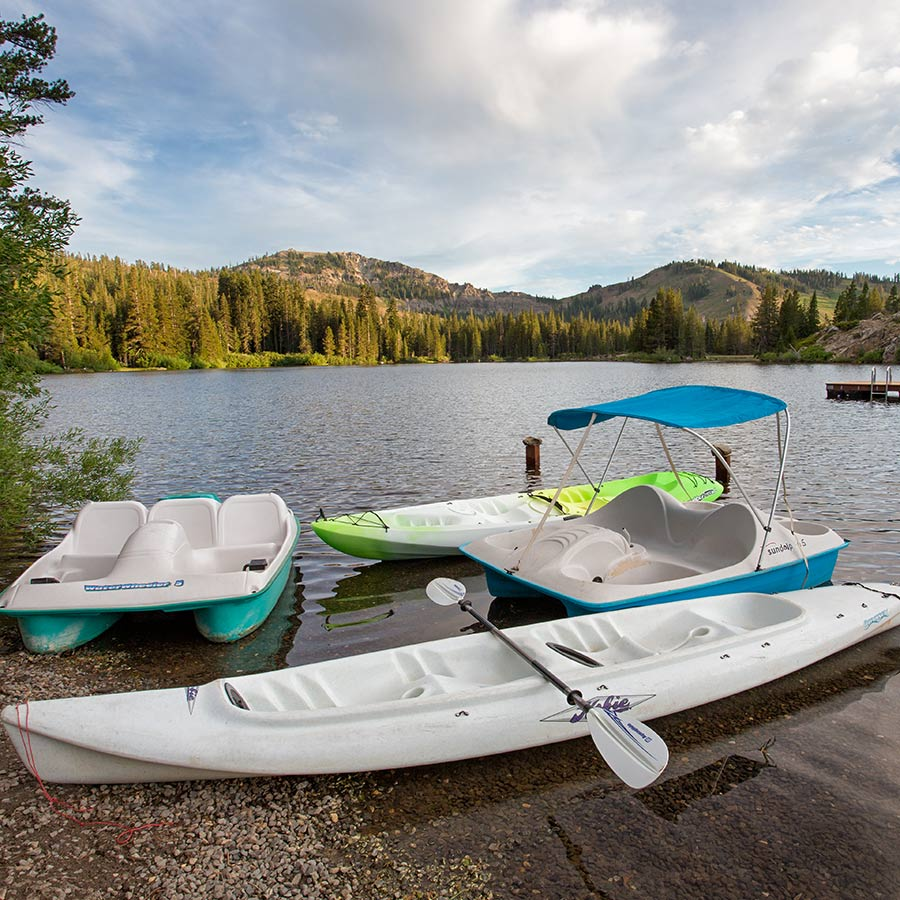 Kayaks and Paddle boats on the shore of Lake Mary are available for use by Sugar Bowl Summer Campers