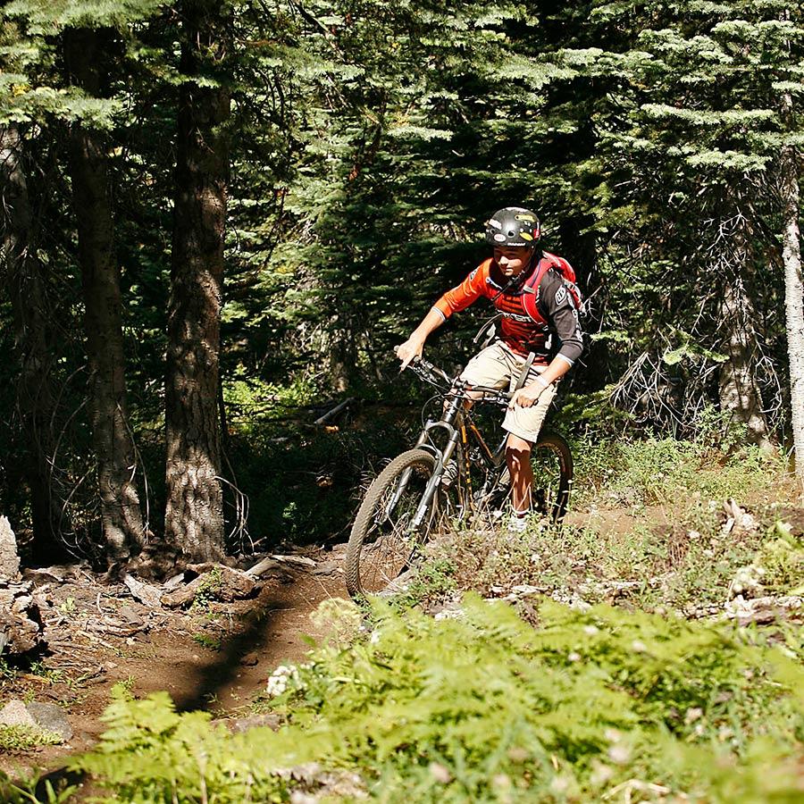 Camper mountain biking at Sugar Bowl Summer Camp