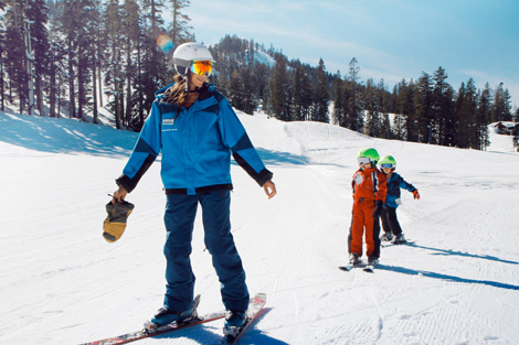 Friendly Sugar Bowl instructor teaching two young students how to ski.