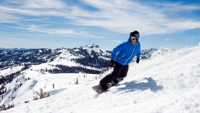 Snowboarded enjoying discounted tickets at Sugar Bowl Ski Resort.
