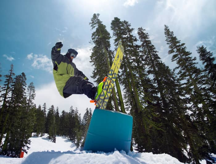 Sugar Bowl Terrain Park. Skier riding up onto a barrel.