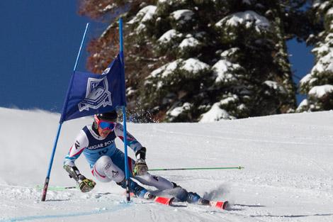 Sugar Bowl Ski Team Member Making a hard turn through a Sugar Bowl gate.