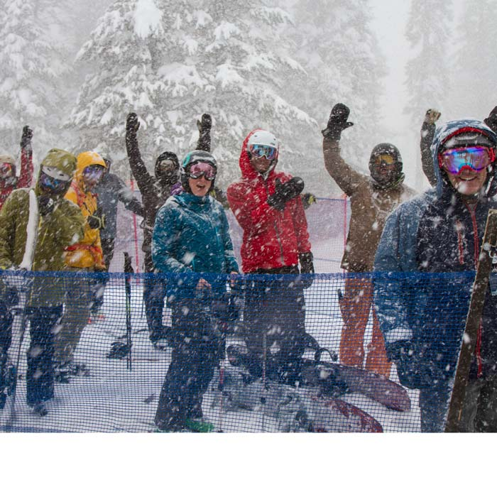 Group of Skier and Snowboarders cheering