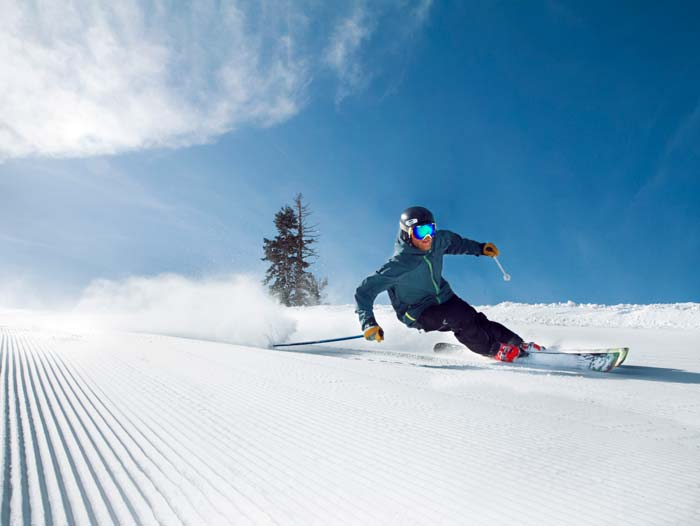 Skier on pristine groomed runs at Sugar Bowl Ski Resort
