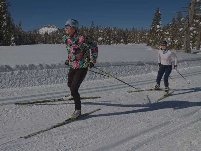 Woman Cross Country skier in a Patagonia fleece classic stride skiing at Royal Gorge